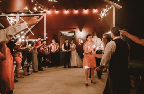 Wedding reception in lighted red barn venue